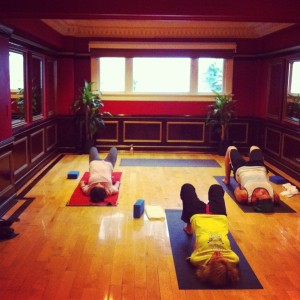 Students working on basic backbending in beginner's class.